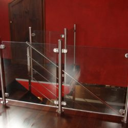 Railing with uprights and glass clamps